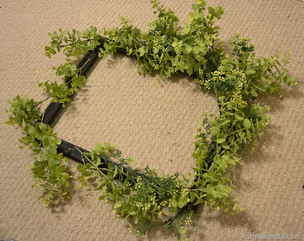 i cut all the stems off the greenery bushes and started hot gluing them all around the frame i probably could have used floral wire and it would have made - Wire Wreath Frame Hobby Lobby