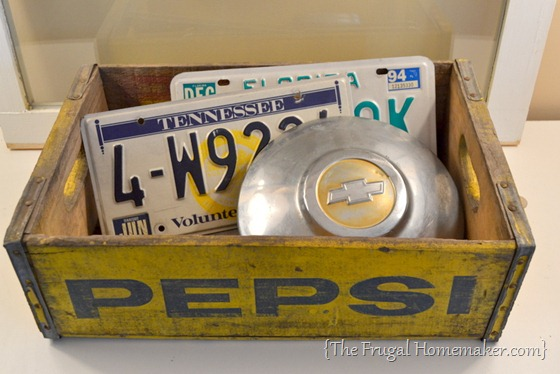 yellow Pepsi crate, license tags