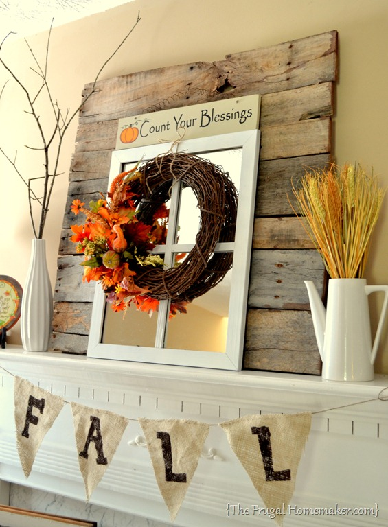Fall mantel decorated with reclaimed pallet wood