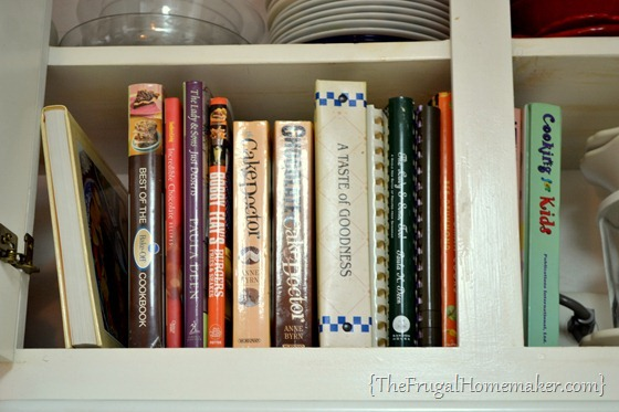cookbooks in cabinet