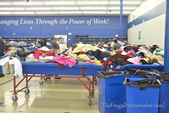 Shopping at a Goodwill oulet (pay by the pound for clothes)