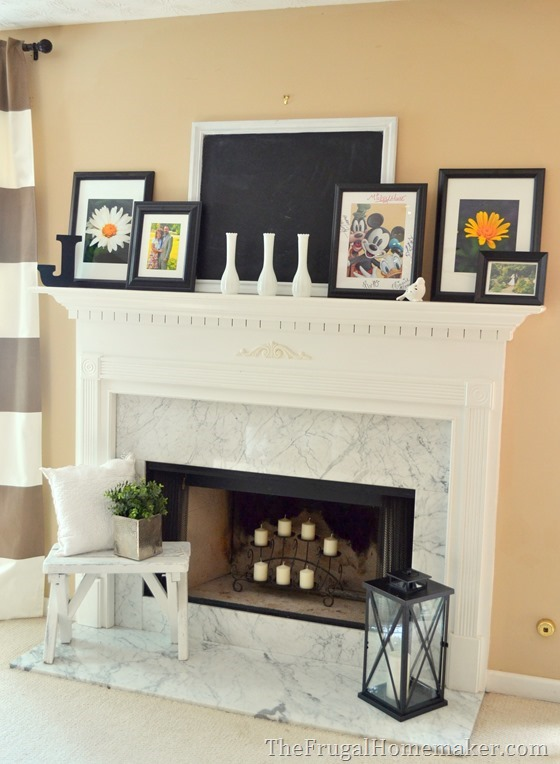 mantel decorated with black and white family photos