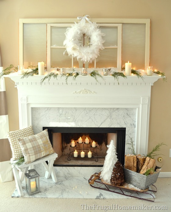 Winter white + green mantel dressed in candlelight