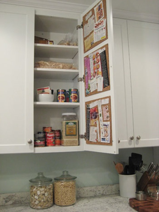 cork board organizing on kitchen cabinet door