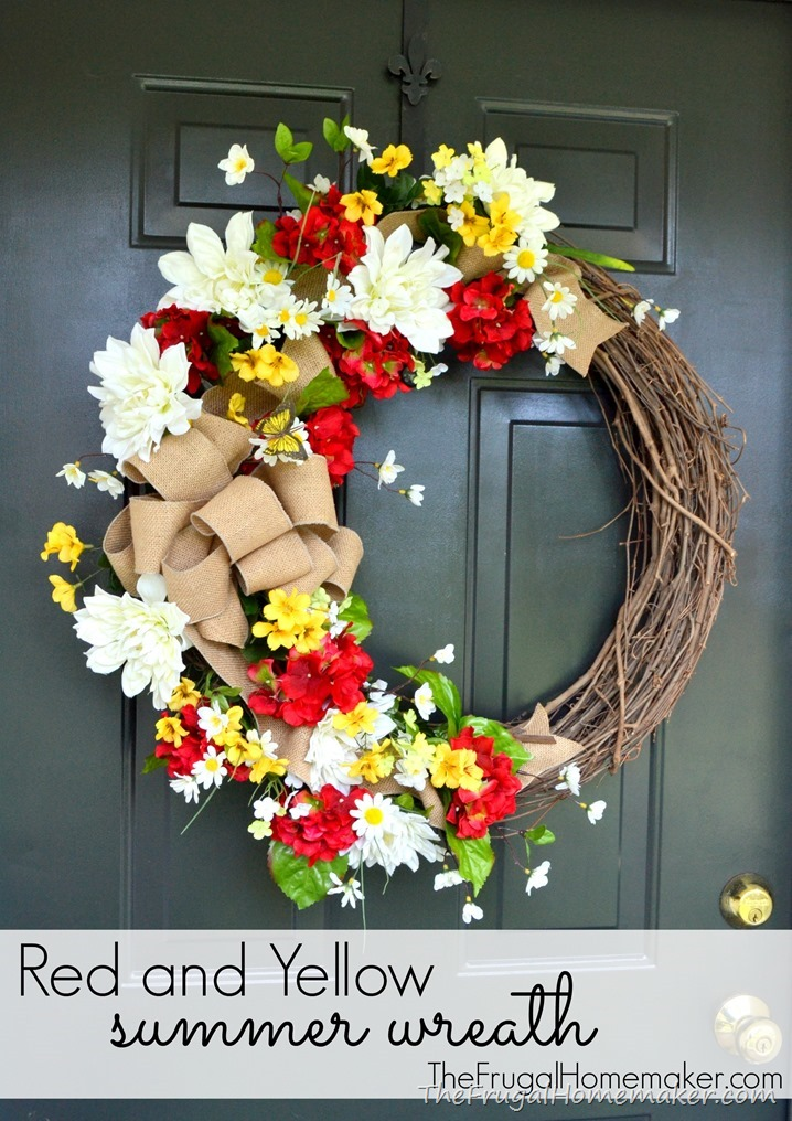 Red and yellow summer wreath with a burlap bow