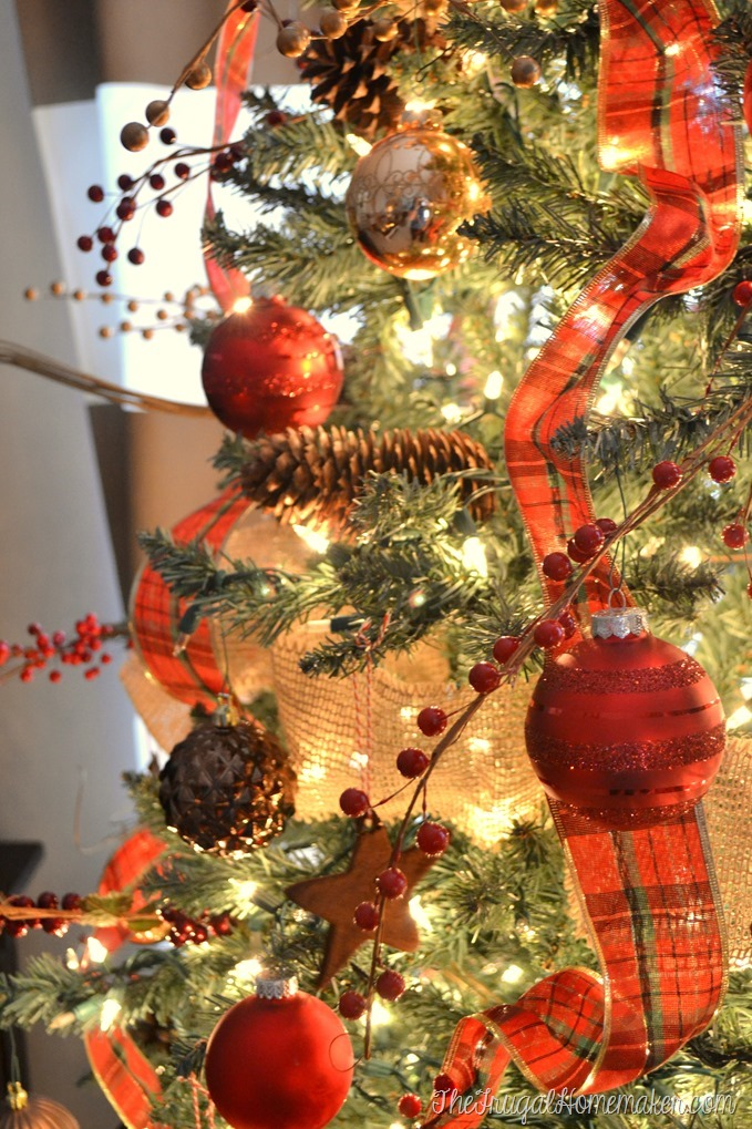 Christmas tree decorated in plaids and burlap and rustic elements