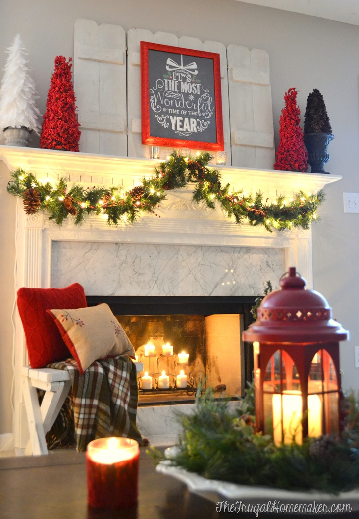 red, white and greenery on Christmas mantel