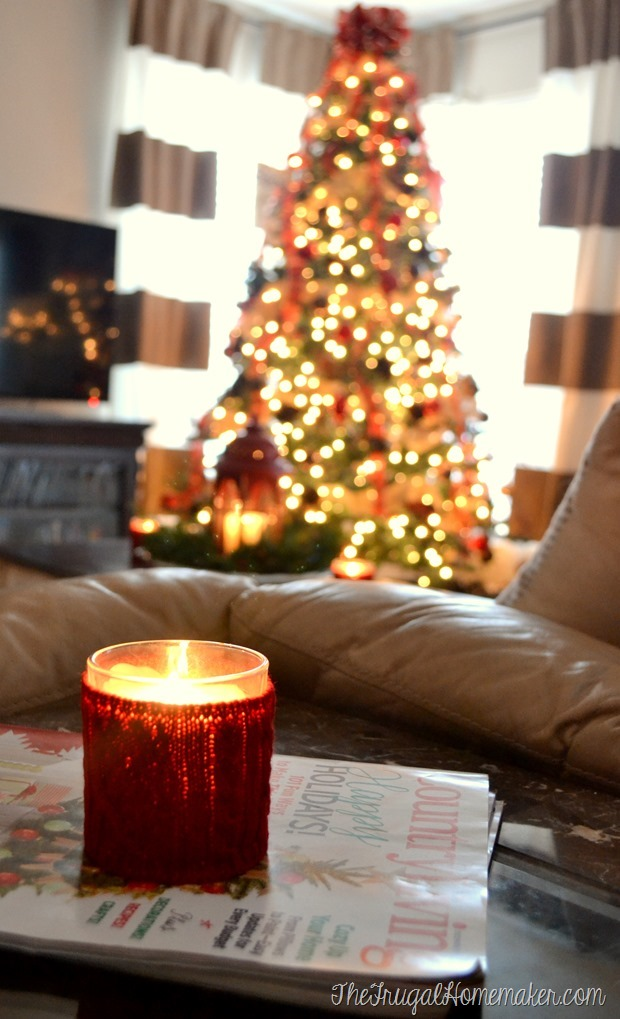 sweater candle on magazines in living room
