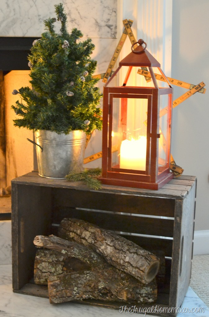 wood in box with lantern on hearth