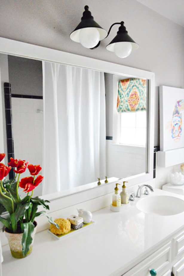 10 diy ideas for how to frame that basic bathroom mirror for How to frame mirror in bathroom