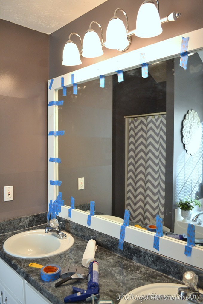 Bathroom Mirror Ideas Diy how to frame out that builder basic bathroom mirror (for $20 or less!)