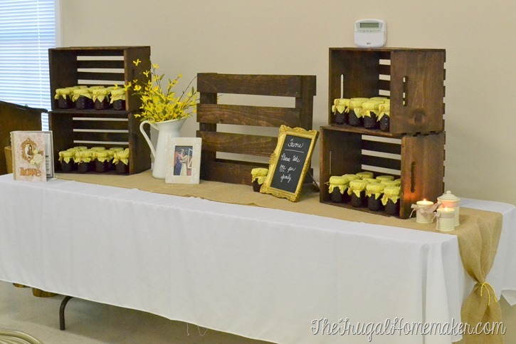 favor table at wedding decorated using wood crates