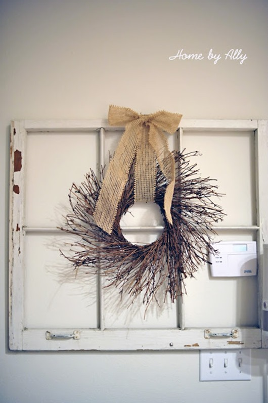 hang twig wreath on old window