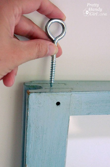 how to hang a window with an eye hook