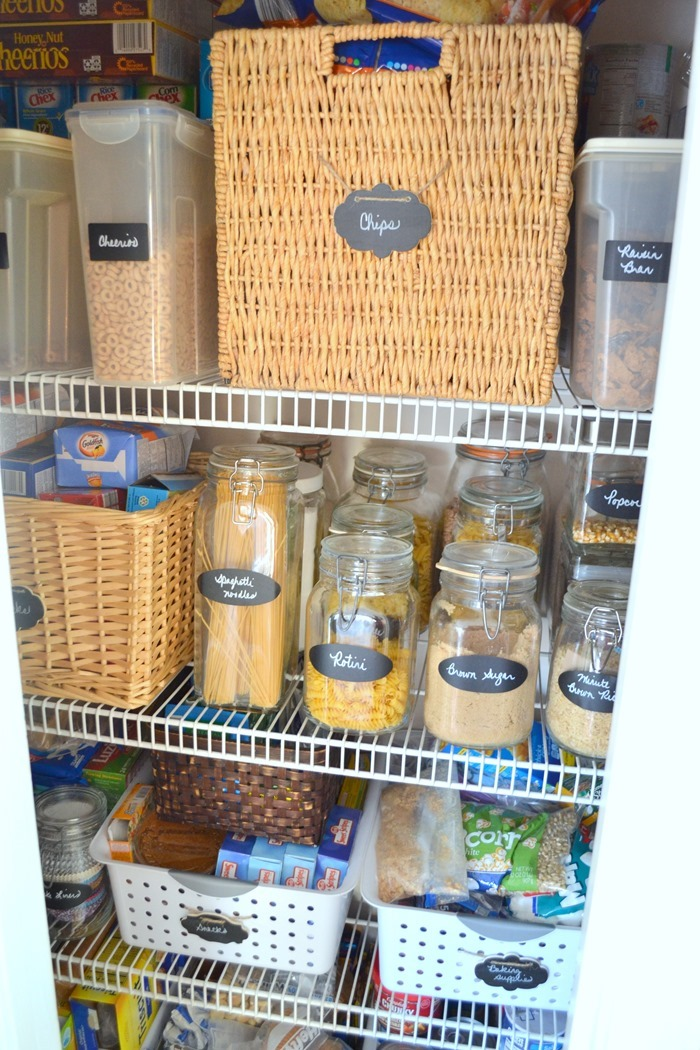 Organize your pantry with baskets and glass jars