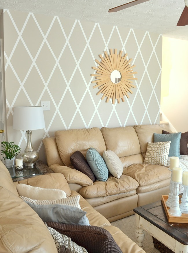 living room with diamond painted wall