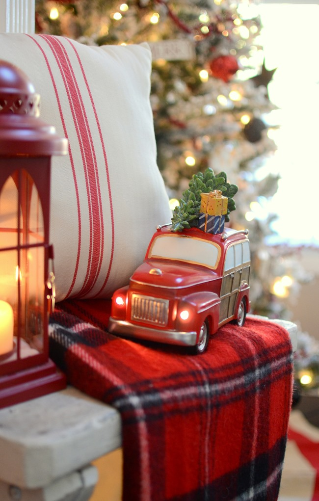 Vintage truck in farmhouse Christmas mantel