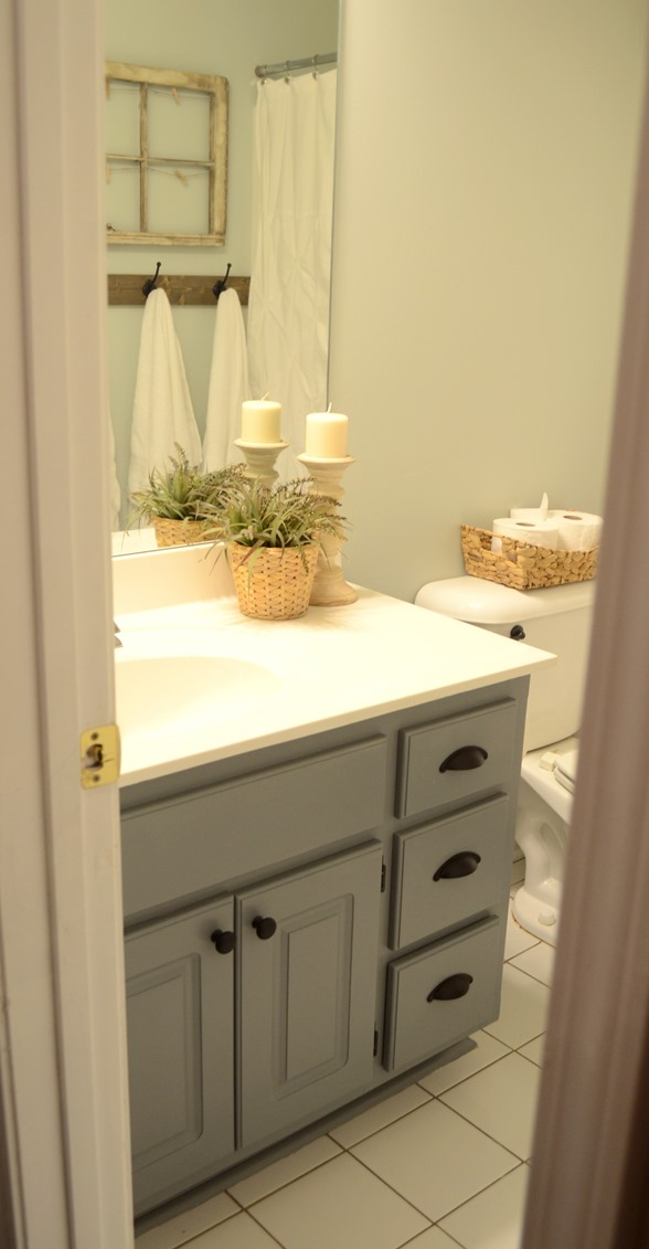 5a890d77de Guest bathroom update – Stained wood framed bathroom mirror