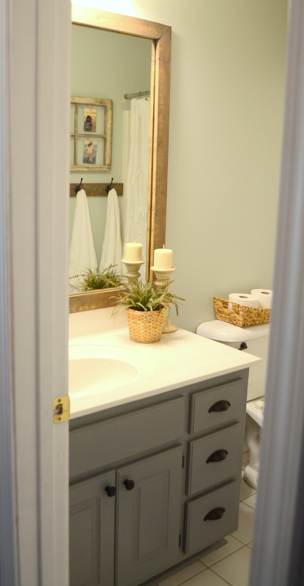 Guest bathroom update – Stained wood framed bathroom mirror
