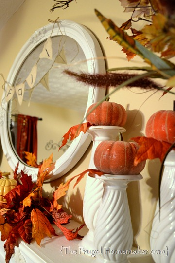 pumpkins on candlesticks - 20 things I love about fall