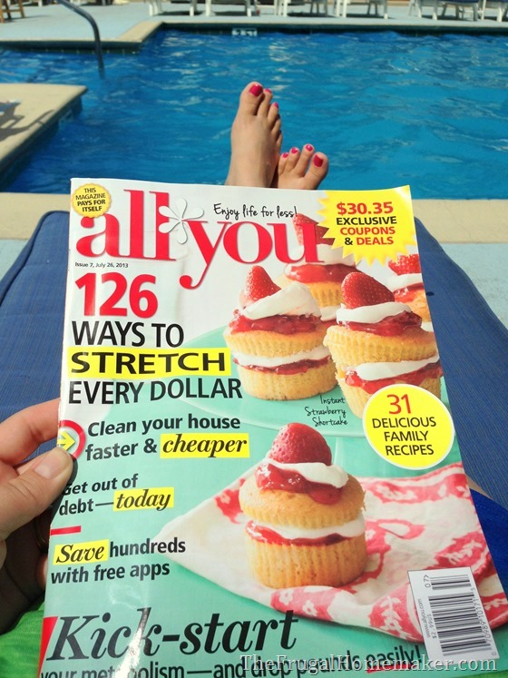 reading All You magazine at the pool