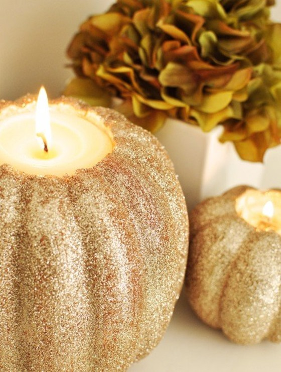 faux pumpkins into candleholders