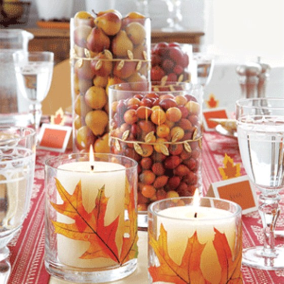 glass centerpiece filled with nuts and fruit