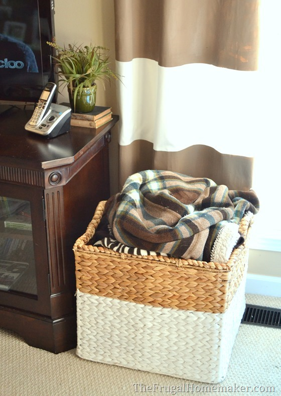 use large basket to store blankets and pillows