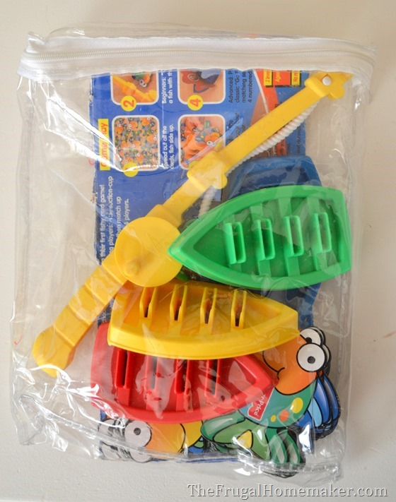 use zippered bags from curtains to organize kids games and puzzles