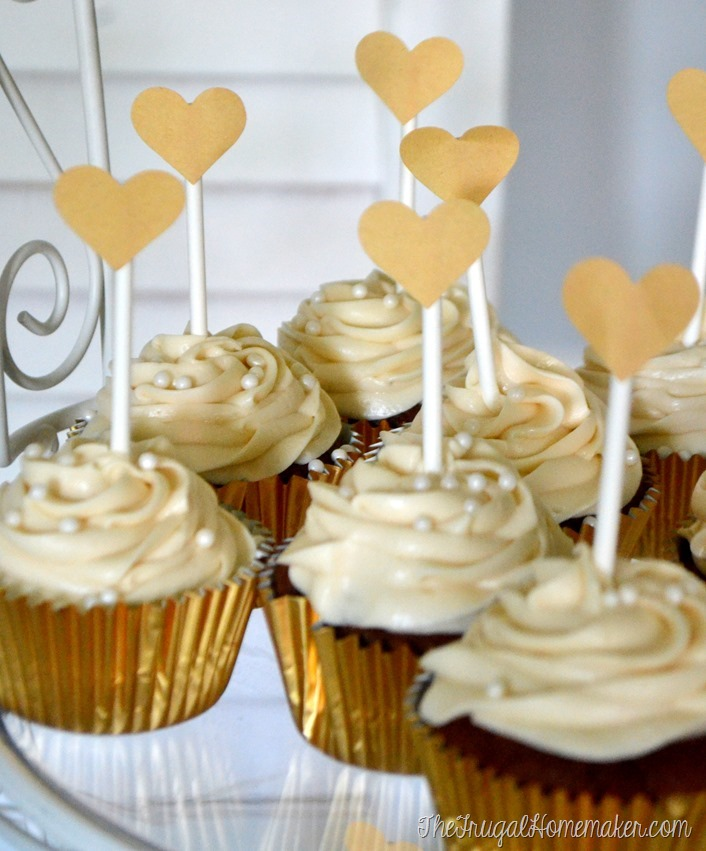 Gold cupcakes topped with hearts