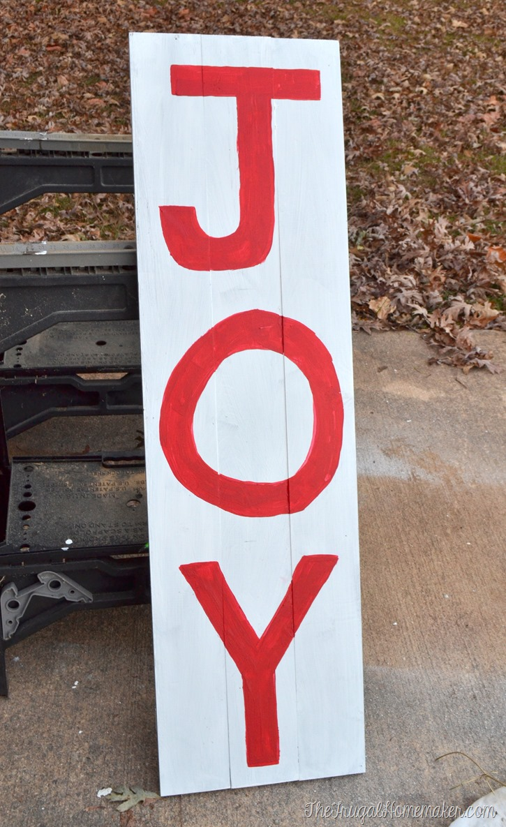 planked wood JOY sign before sanding