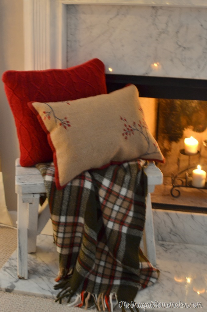 placemat pillow and white bench with plaid throw