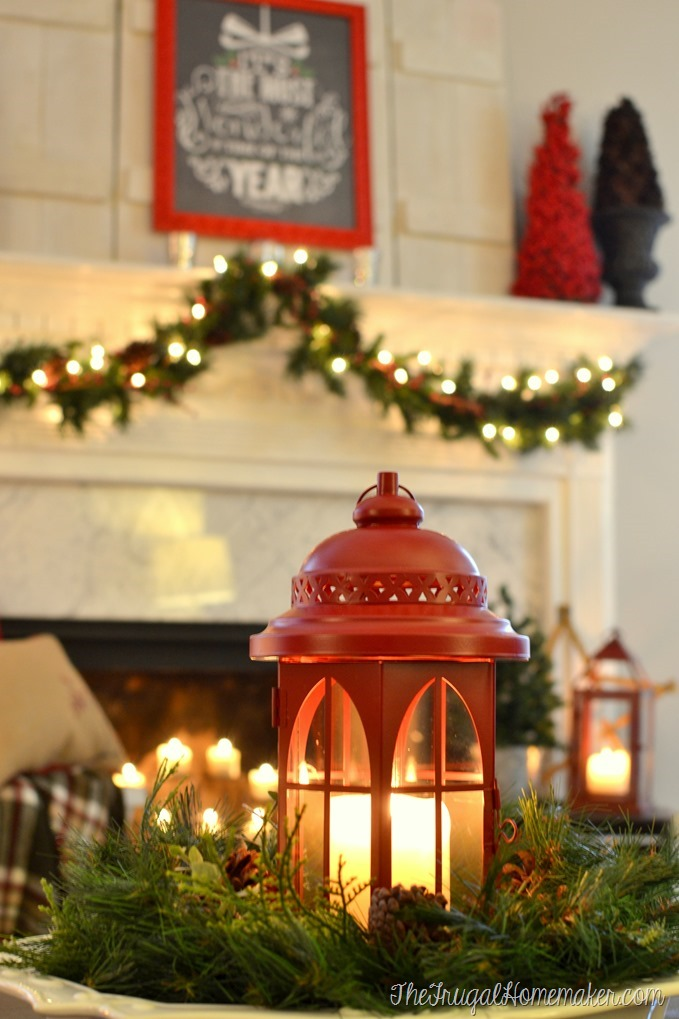 red lantern centerpiece on coffee table and mantel