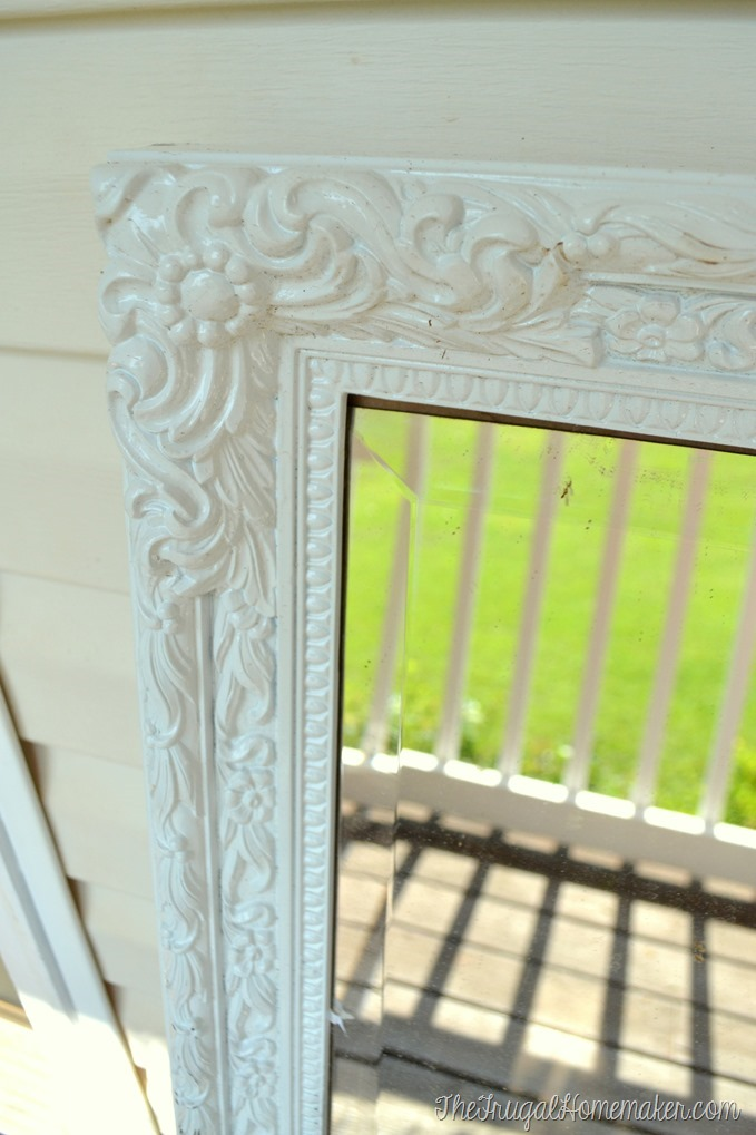 detail of white spray painted mirror