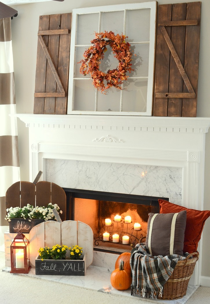 Rustic Fall mantel with DIY farmhouse shutters and DIY Wood Pumpkin Stands