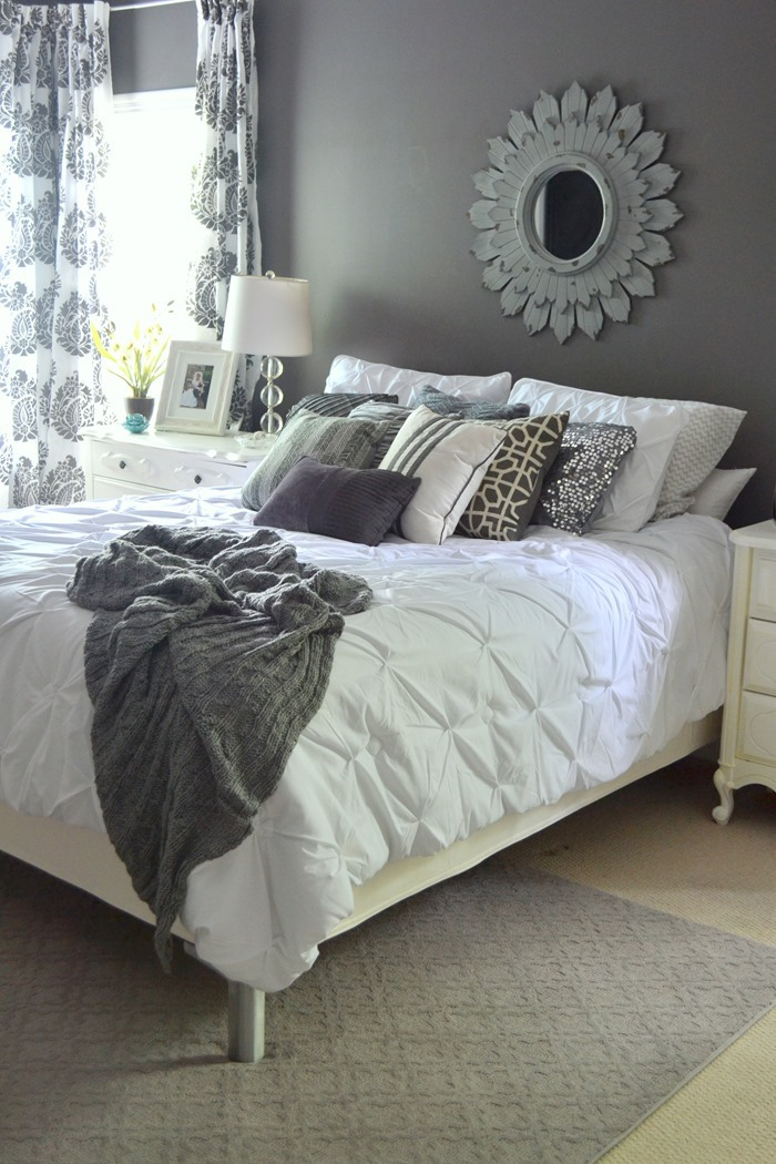 white bedding on bed in master bedroom