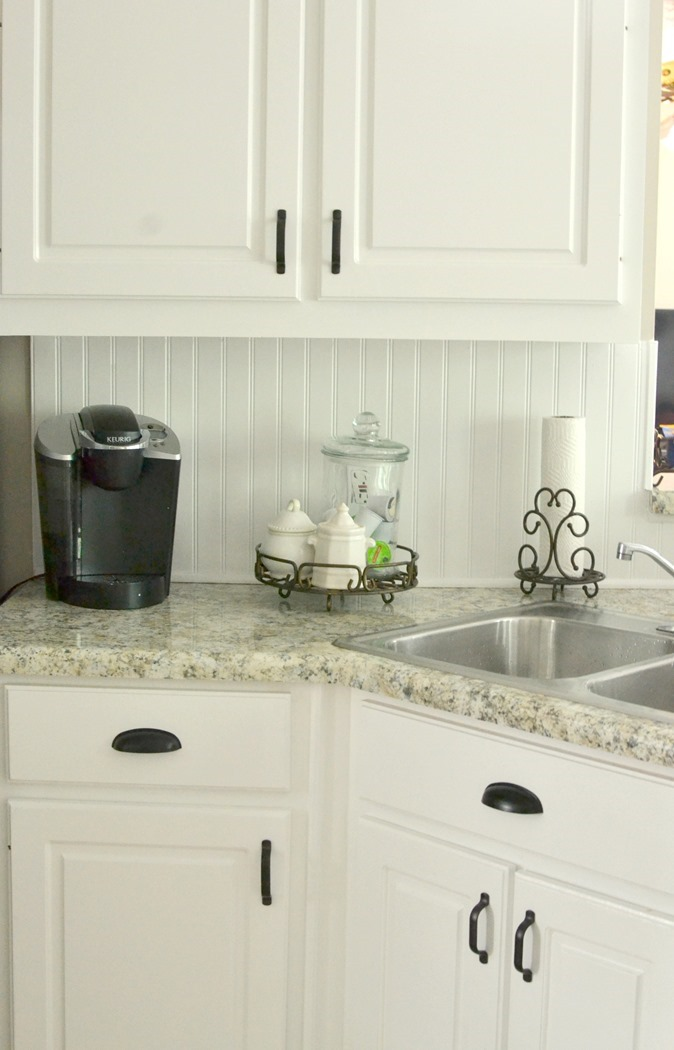 how to repaint your yucky kitchen cabinets