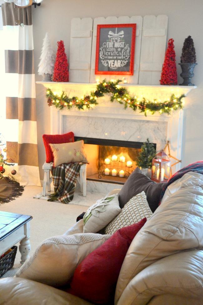 Christmas living room view of mantel and tree