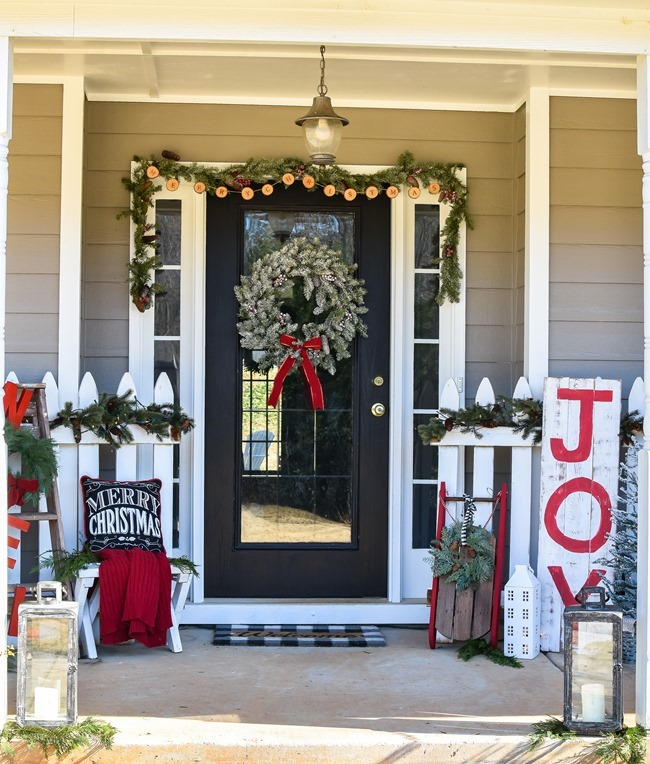Farmhouse style Christmas front porch with picket fences-11