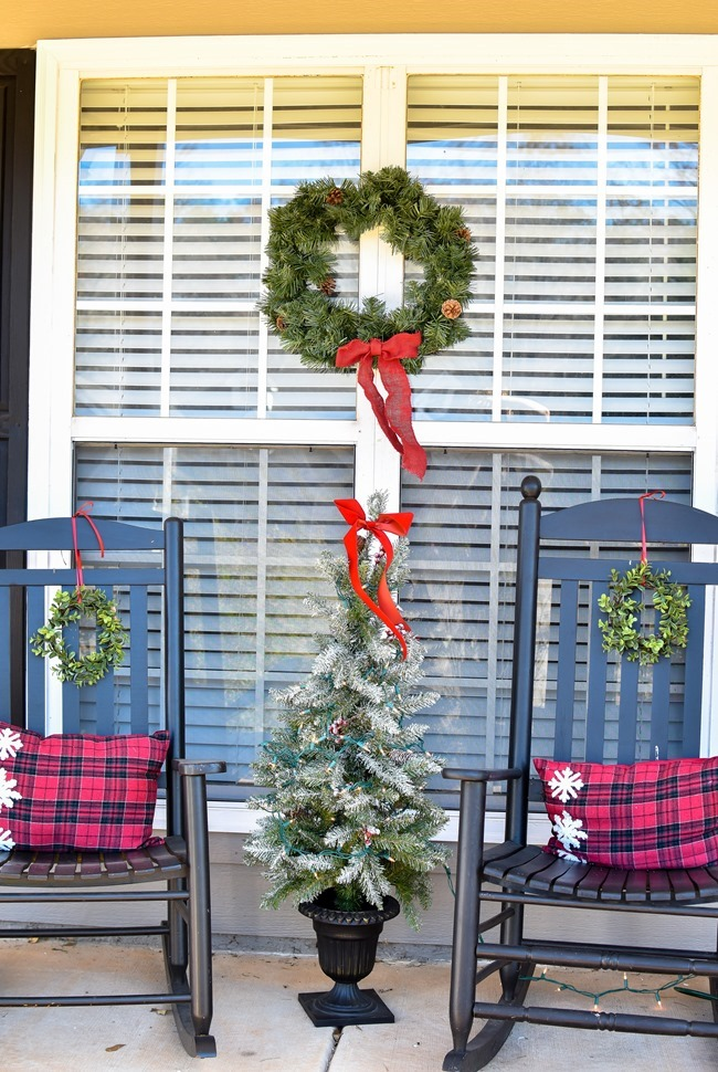 Farmhouse style Christmas front porch with picket fences-15