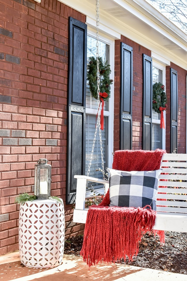 Farmhouse style Christmas front porch with picket fences-16