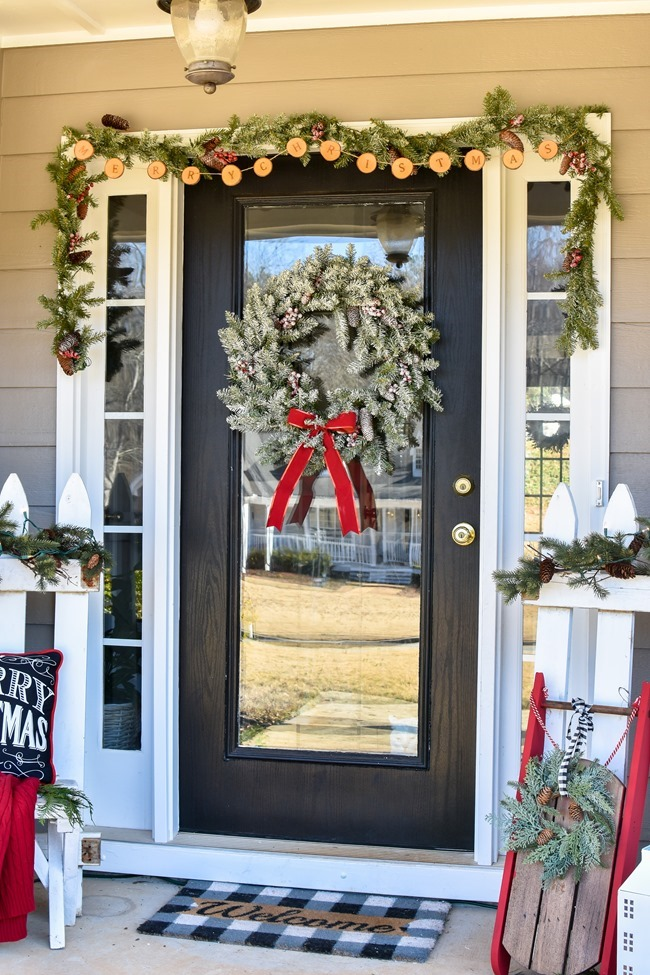 Farmhouse style Christmas front porch with picket fences-18