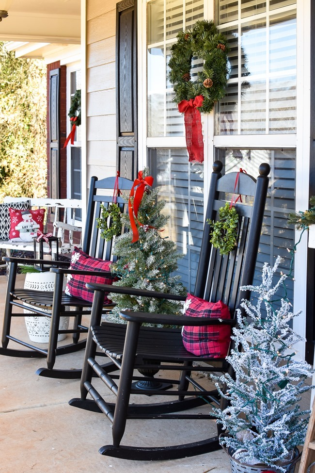 Farmhouse style Christmas front porch with picket fences-2