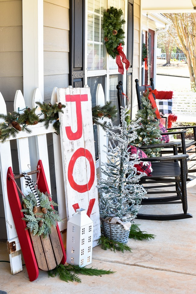 Farmhouse style Christmas front porch with picket fences-21