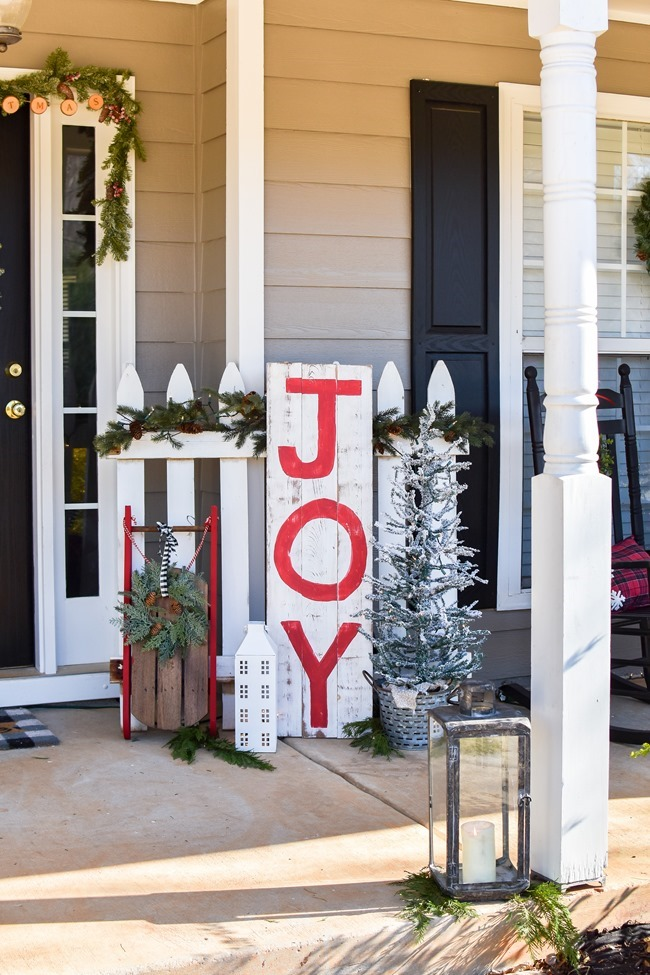 Farmhouse style Christmas front porch with picket fences-25