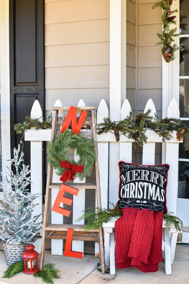 Farmhouse style Christmas front porch with picket fences-28