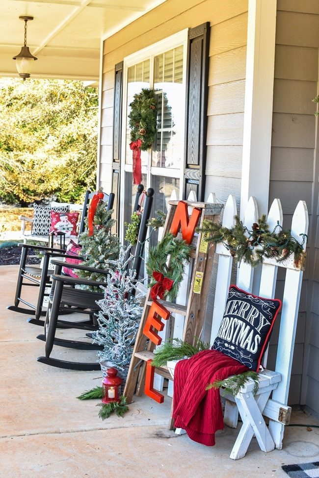 Farmhouse style Christmas front porch with picket fences-3