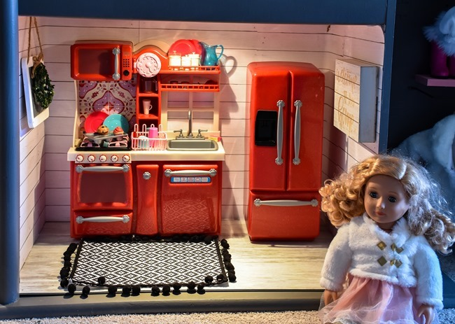 Old entertainment center turned American Girl dollhouse-10