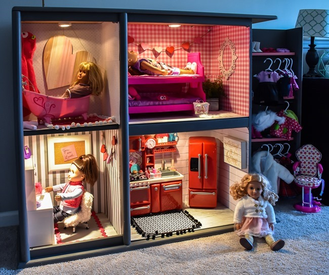 Old entertainment center turned American Girl dollhouse-14