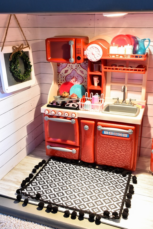 Old entertainment center turned American Girl dollhouse-16